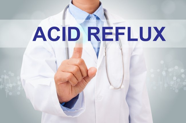 illustrator of doctor pointing Acid Reflux