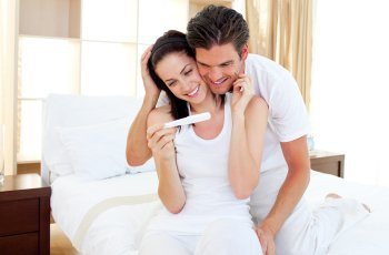 couple are happy with pregnancy test