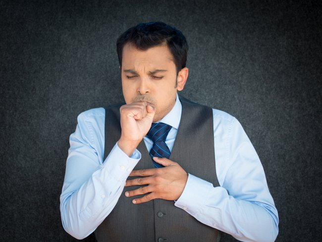 A boy coughing