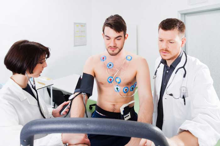 interpretation of the electrocardiogram of young athlete, monitored by the doctor and nurse
